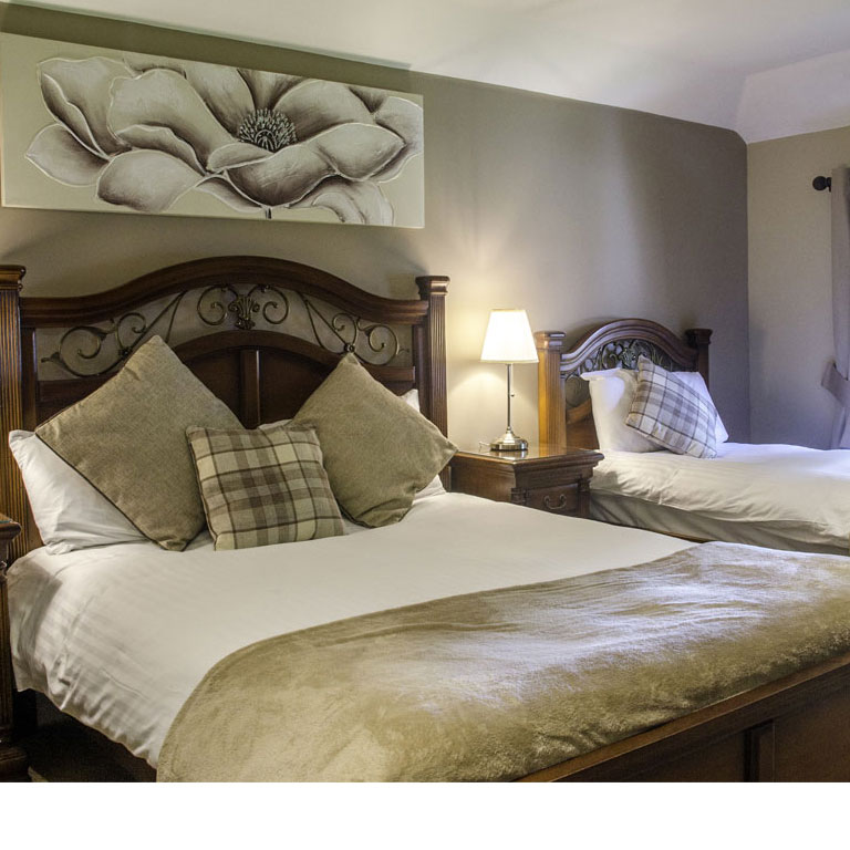 A cosy room with a double bed